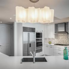 White Contemporary Corner Kitchen With Glass Bottles