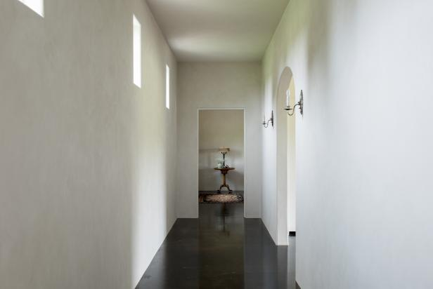 White Hallway With Sconces