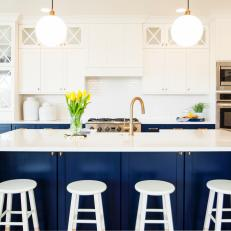 Delightful Navy Blue And White Kitchen Featuring Large Cabinets And Kitchen Island  With Stools