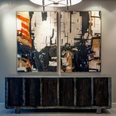 Entryway With Striking Modern Art & Black Distressed Sideboard
