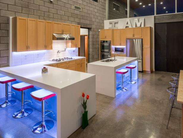 Neutral Urban Industrial Kitchen With Pink Barstools