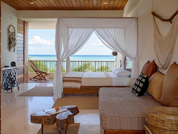 White and Brown Ocean View Bedroom With Canopy Bed