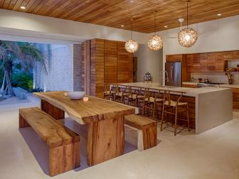 Wood-Paneled Kitchen and Dining Room With Wood Table