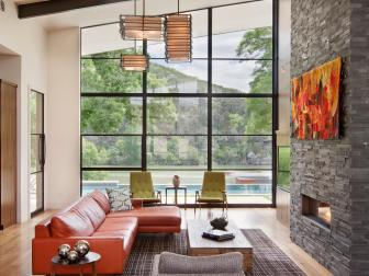 Open, Contemporary Living Room Features Natural Stone Fireplace