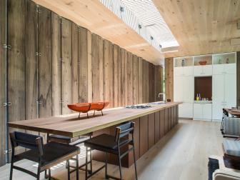 Modern Wood Galley Kitchen and Dining Space