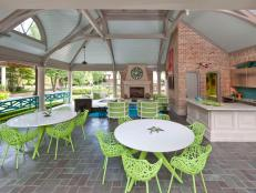Outdoor Living Area Features Kitchen & Ample Dining Space