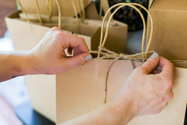 Keep string and scissors handy so guests can secure bags and cartons before leaving