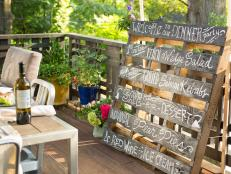 Add a little sophistication to your next dinner party with this chalkboard menu board upcycled from an old wood pallet.