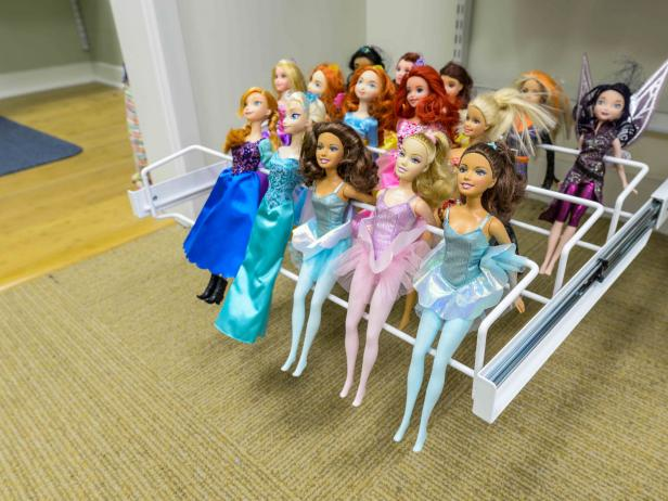 Dolls Stored on Shoe Rack