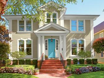 Neutral Traditional Home Exterior With Bright Blue Door