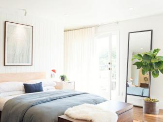 Bright White Master Bedroom With Colorful Rug