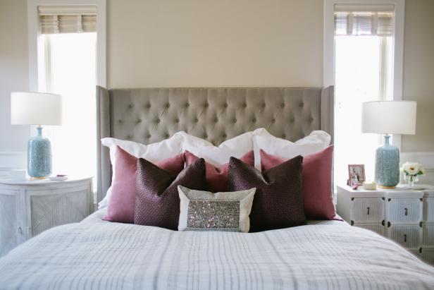 Peaceful Master Bedroom Features Plum & Mauve Pillows and Tufted Headboard