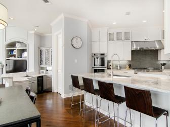White Transitional Open Plan Kitchen With Clock