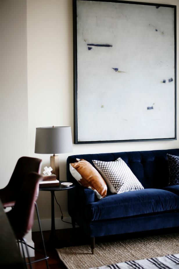 Navy Blue Velvet Sofa & Minimalist Art