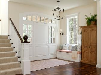 Contemporary White Foyer with Storage Bench and Armoire