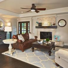 Contemporary Living Room With Brick Fireplace And Blue Patterned Area Rug