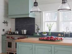 White Cottage Kitchen With Glass Pendant Lights