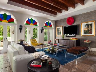 Eclectic Family Room With Exposed Beams