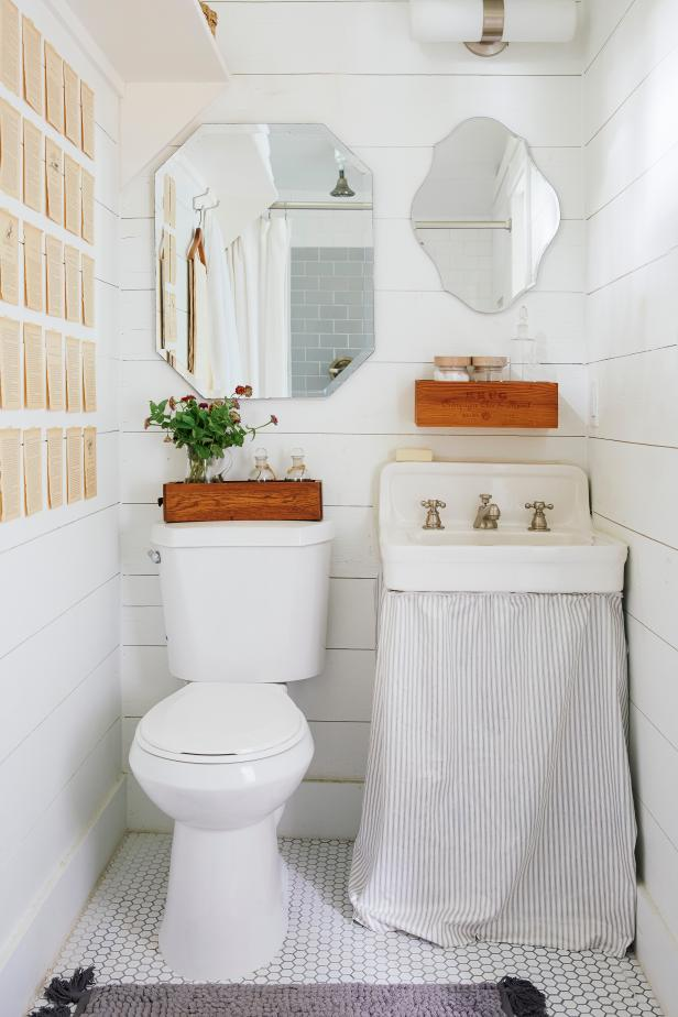 Bright Country Bathroom With Book-Page Wall Decor & Skirted Sink