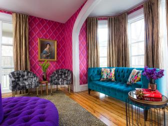 Vibrant Sitting Room With Hot Pink Walls and Bold, Tufted Furniture
