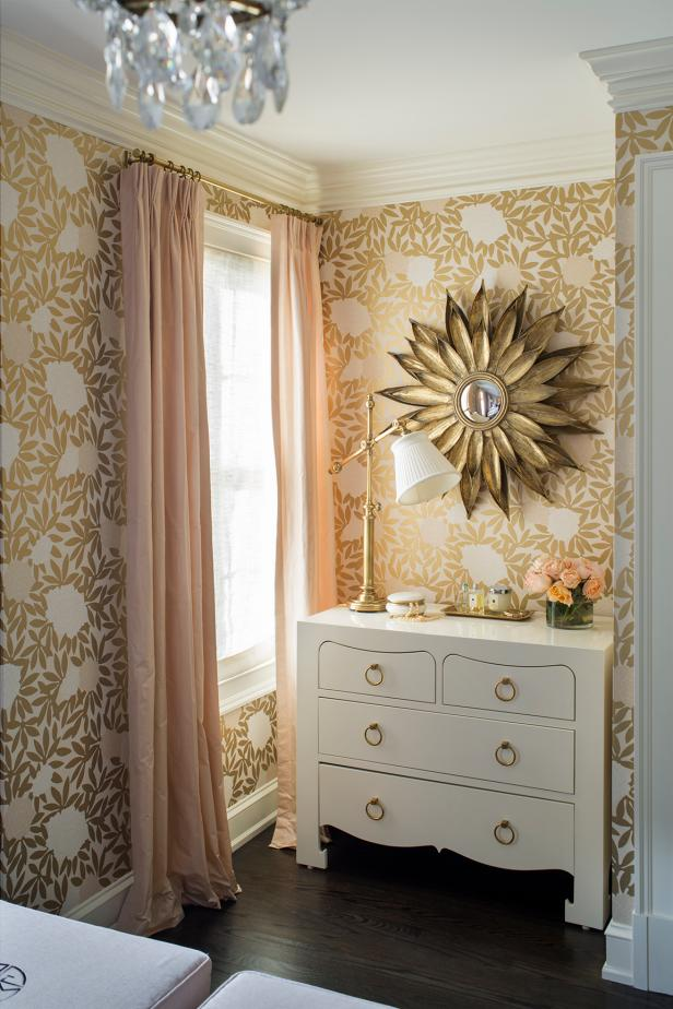 Bedroom Features Pretty Gold Wallpaper & White Dresser