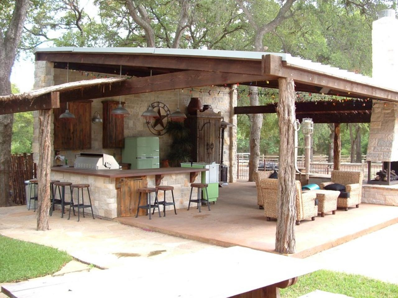 Ranch style entertaining a rustic covered outdoor kitchen for Outdoor cabana designs