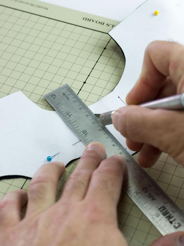 "On one set of wings, use the lines near the center of the template to cut two 2"" lines with a craft knife and ruler."