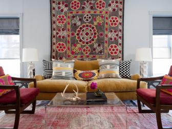 Eclectic Living Room With Mustard Yellow Sofa, Patterned Wall Tapestry and Mixed Decorative Throw Pillows