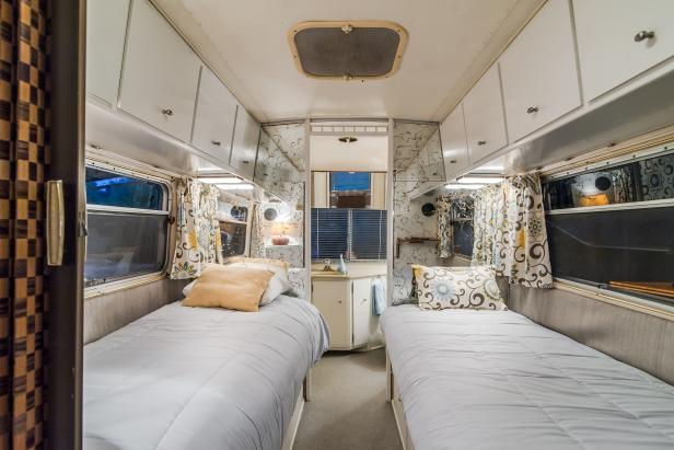 White Bedroom With Floral Curtains in Trailer