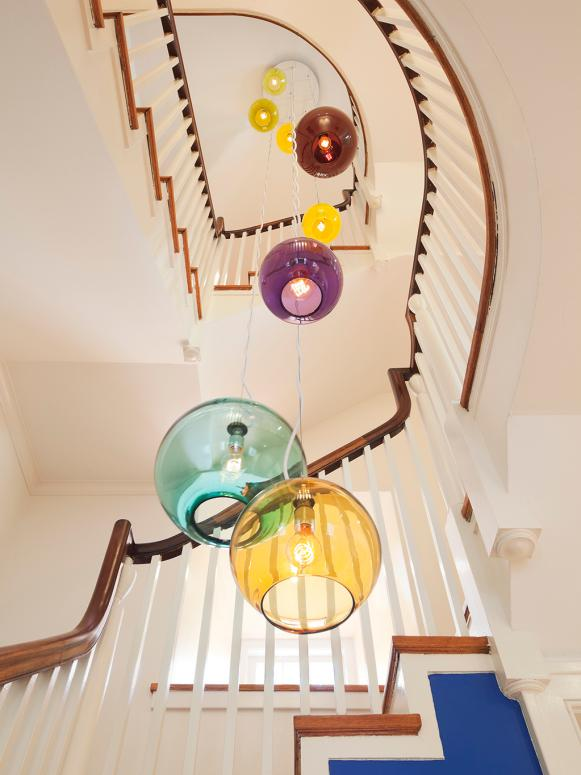 Colorful Chandelier Illuminates Traditional Stairway