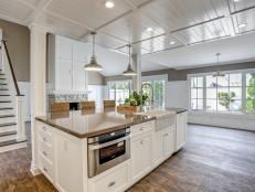 Airy White Kitchen With Rustic Hardwood Floors