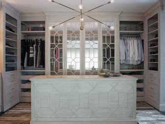 Gray Walk-In Closet With Chandelier