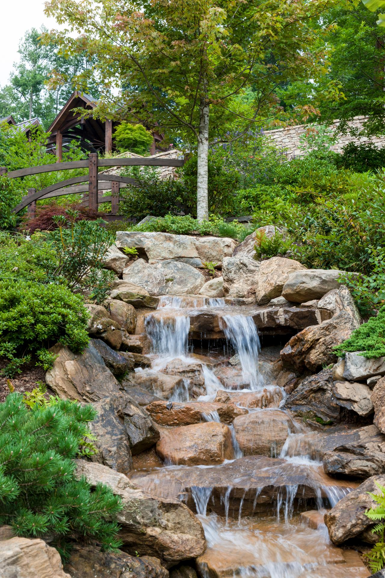 Outdoor spaces design guide hgtv for Garden pond water features