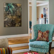 Living Room Entry With Dimensional Art and Bold Color