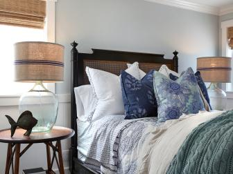 Blue Coastal Bedroom With Patterned Pillows
