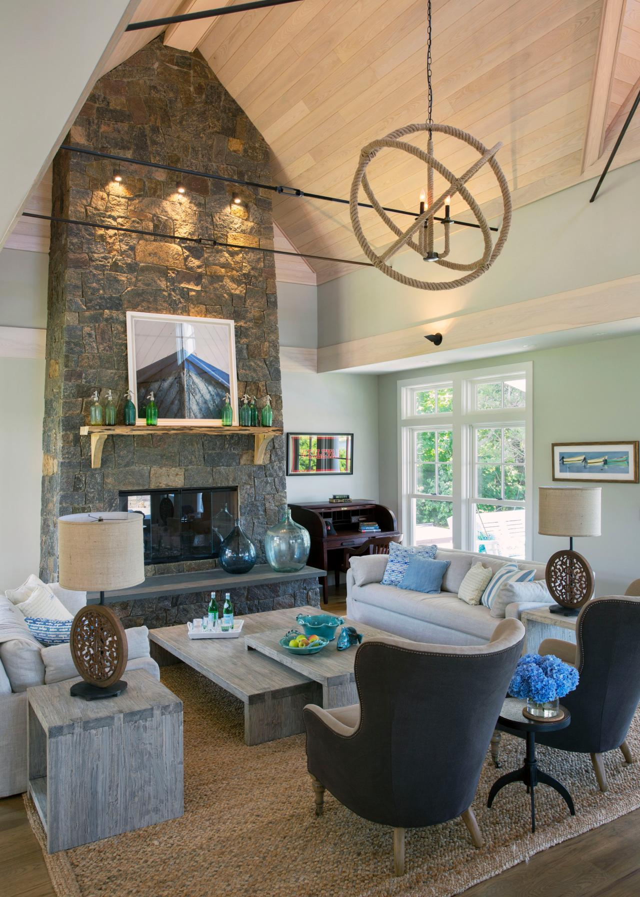 Cape cod great room with stone fireplace hgtv - Cape cod house interior ...