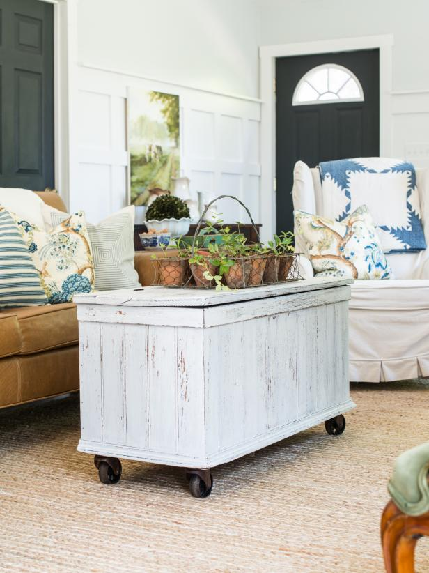 Old wooden trunks are stowed away in many attics and often end up in yard sales or thrift stores at a great price.  Give one of them an update by simply adding casters to make it a functional (and mobile) coffee table.