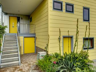 Modern Rear Home Exterior with Bright Yellow Door