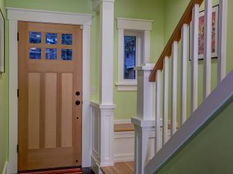 Bright Green Entry With Unstained Wood Front Door and White Trim