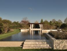 Contemporary Sandstone Swimming Pool with Rim Flow Edge