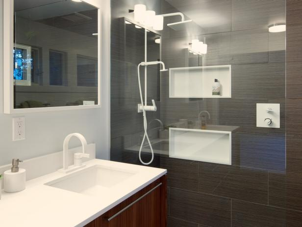 Midcentury Modern Bathroom Features Sleek Shower With Niches