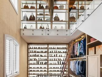 Two-Story Walk-In Closet With Bronze Chandelier