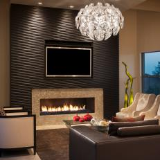 Living Room With Wood Clad Accent Wall Fireplace And Modern Chandelier