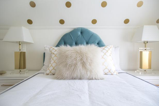 Blue Headboard Adds Color to White and Gold Bedroom