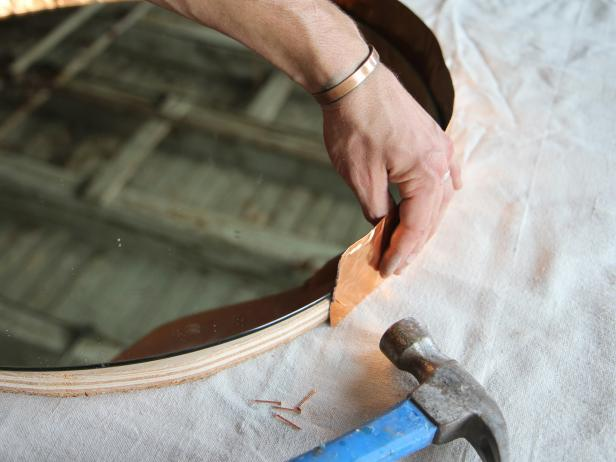 Attach copper flashing to frame by nailing it into the frame with copper pin nails.