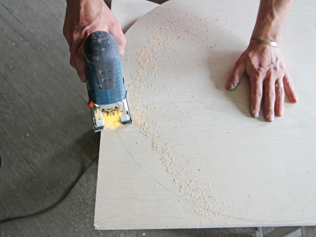 Cut plywood using a jigsaw.