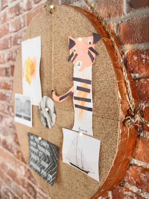 Hang memos and your kids' art on a round bulletin and mirror that has a copper edge accent.