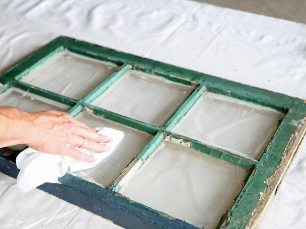 Wipe away dust and debris from window panes with a dry cloth.
