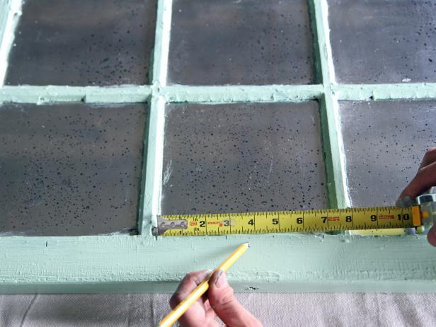 Measure for the center of each window frame at the bottom, and make a mark with a pencil.