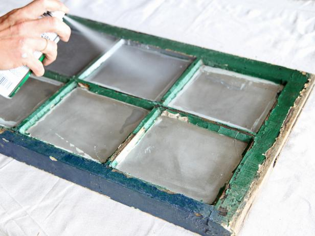 Spray glass panes with mirrored spray paint.